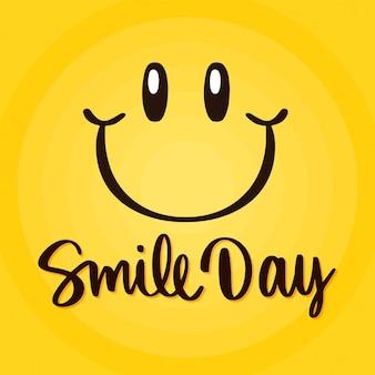 Lettrage de la journée mondiale du sourire avec visage
