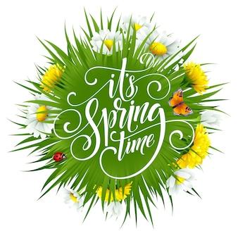 Lettrage à la main de printemps avec des fleurs.