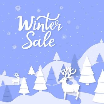 Lettrage à la main des soldes d'hiver. montagnes de paysage, épinette, cerf découpé dans le style de papier. affiche publicitaire, bannière pour noël et nouvel an.