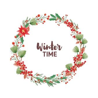 Lettrage manuscrit de l'heure d'hiver à l'intérieur d'un cadre rond ou d'une couronne de vacances faite de branches de pin avec des cônes, des poinsettia et des feuilles d'ilex ou de houx