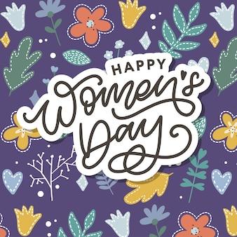 Lettrage manuscrit de la journée de la femme heureuse.