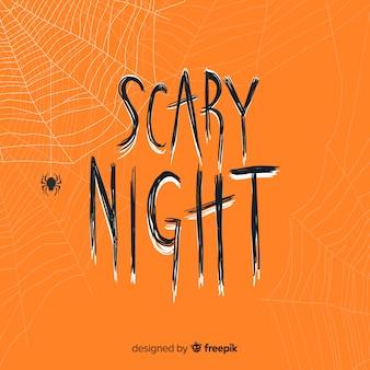 Lettrage de nuit effrayant orange avec toile d'araignée