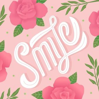 Lettrage de sourire avec ornement de fleurs