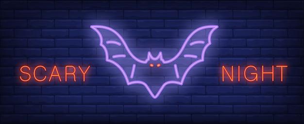 Lettrage de style néon nuit effrayante avec chauve-souris rougeoyante sur le mur de briques. bannière de nuit lumineuse.
