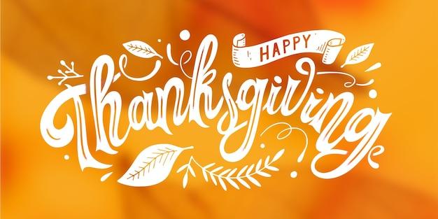 Lettrage de thanksgiving heureux sur fond flou