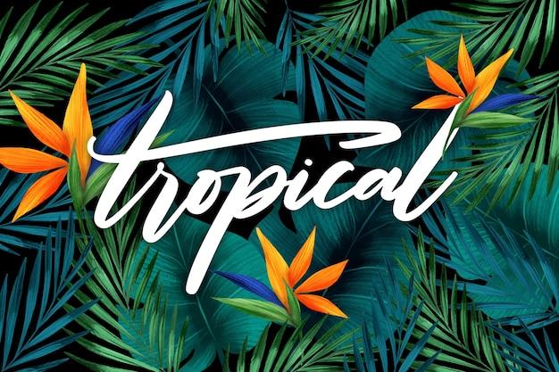 Lettrage tropical avec des feuilles ou des fleurs