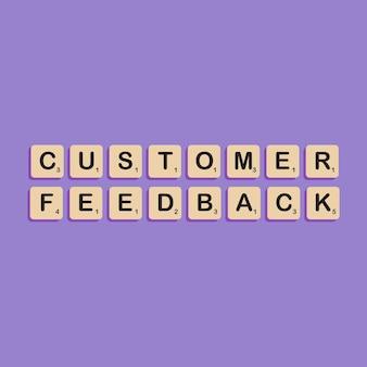 Lettrage typographique des commentaires des clients dans le concept de l'alphabet bloc scrabbles