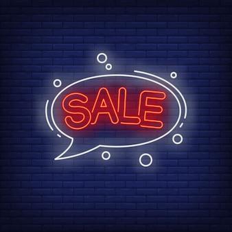 Lettrage de vente au néon dans une bulle de dialogue.