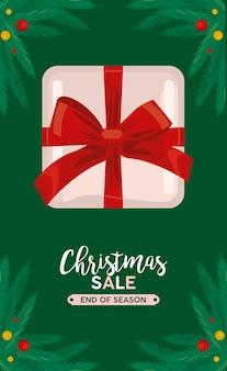 Lettrage de vente joyeux noël avec illustration de cadre cadeau et feuilles