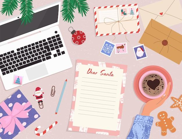 Lettre d'écriture à la liste de souhaits du père noël tasse de café et de rêves à la main