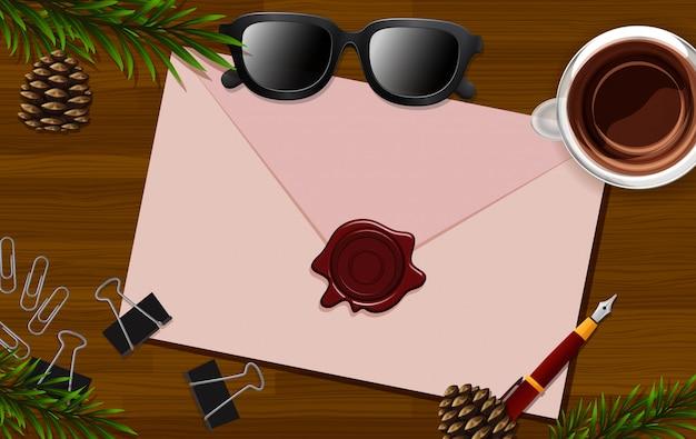 Lettre gros plan sur fond de bureau avec des lunettes et des accessoires de feuilles
