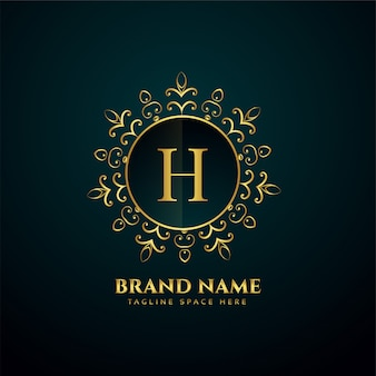 Lettre de luxe h oranmental logo doré