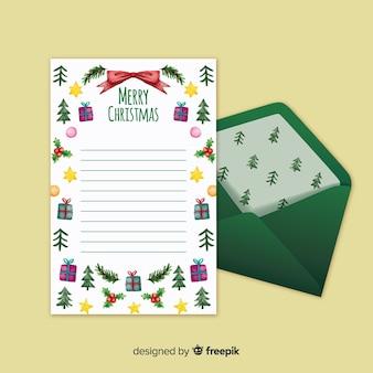 Lettre de noël avec enveloppe de motif de pin