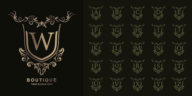 Lettre w ou alphabet initial de collection avec modèle de logo doré cadre floral ornement de luxe.