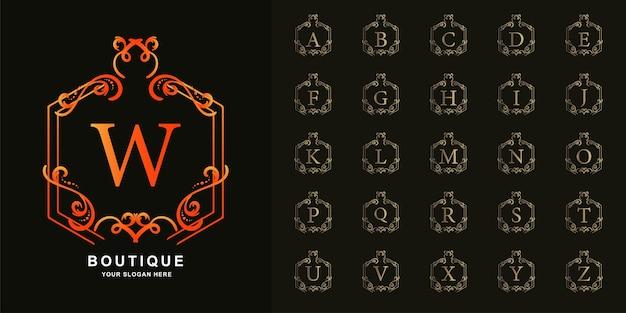 Lettre w ou alphabet initial de collection avec modèle de logo doré de luxe ornement cadre floral.