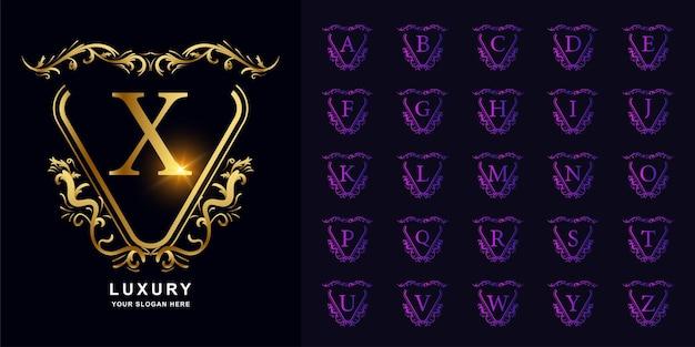 Lettre x ou alphabet initial de collection avec le modèle de logo doré de cadre floral d'ornement de luxe.