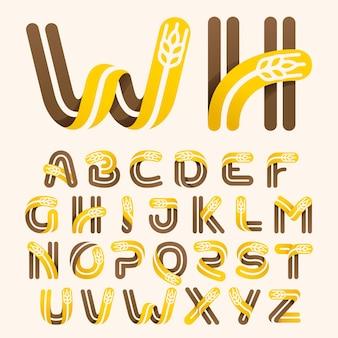 Lettres de l'alphabet avec du blé de l'espace négatif. police vectorielle parfaite pour l'identité de la boulangerie, badges ou emblèmes pour les produits frais naturels, etc.