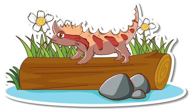 Lézard épineux de dragon se tenant sur un autocollant de journal