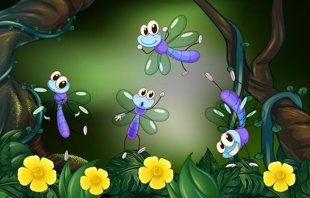 Les libellules volant dans la forêt profonde