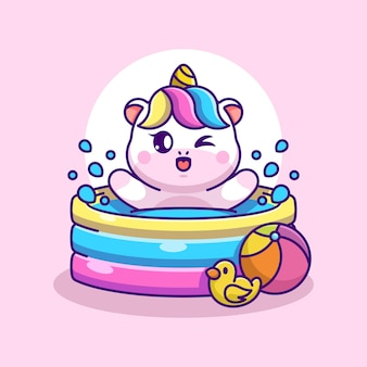 Licorne mignonne jouant dans une piscine gonflable