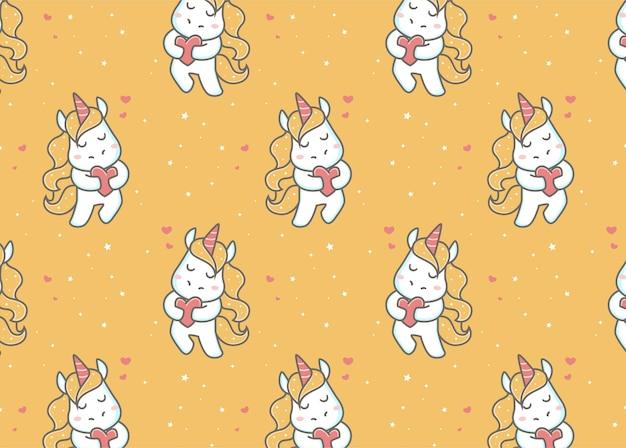 Licorne mignonne tenant un motif de signe d'amour