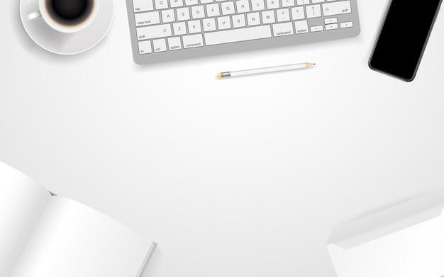 Lieu de travail de bureau avec différents accessoires commerciaux. modèle pour un texte