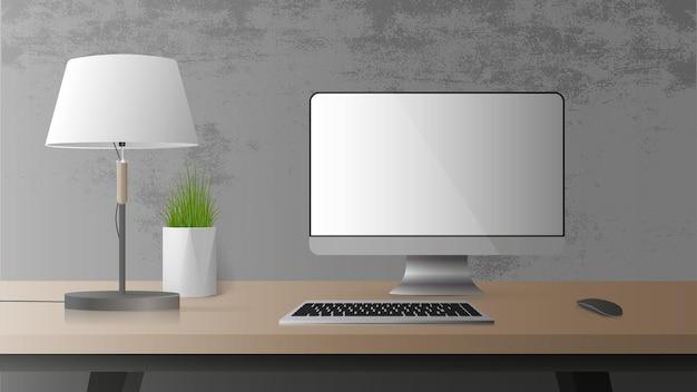 Lieu de travail de bureau. moniteur, clavier, souris d'ordinateur, lampe de table, plante d'intérieur.
