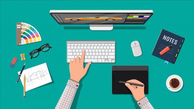 Lieu de travail de concepteur. bureau illustrator avec outils