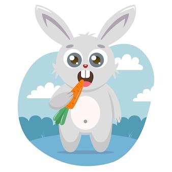 Un lièvre mignon tient une carotte dans sa patte et mange