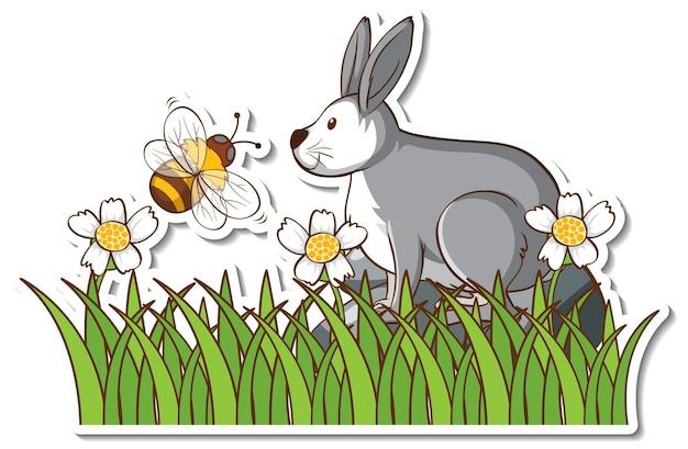 Un lièvre avec une petite abeille dans un champ d'herbe autocollant