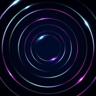 Lignes abstraites de cercles fluorescents bleus et roses avec des néons lumineux sur fond noir.