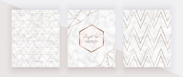 Lignes dorées géométriques sur la texture du marbre. conception de la couverture avec des cadres en marbre, des lignes de chevrons dorés.