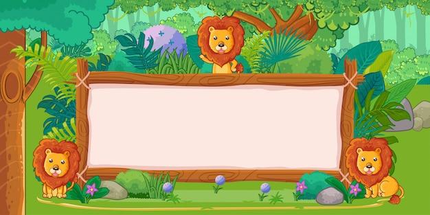 Lions avec une enseigne vierge en bois dans la jungle