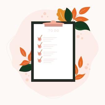 Liste de contrôle sur papier presse-papiers avec des éléments botaniques.