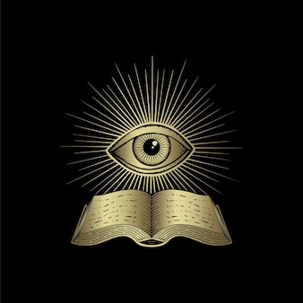 Livre ancien et oeil isolé sur fond noir