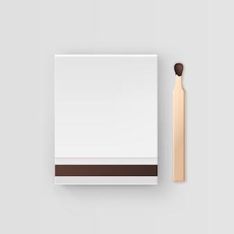 Livre blanc fermé d'allumettes vue de dessus sur fond blanc
