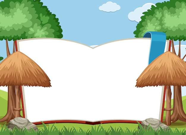 Livre géant avec une page blanche dans le fond du jardin