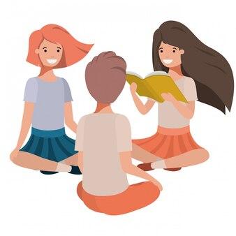Livre de lecture de jeunes étudiants assis