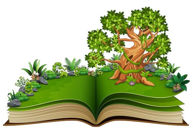 Livre ouvert avec arbre et plante verte de fond de la nature