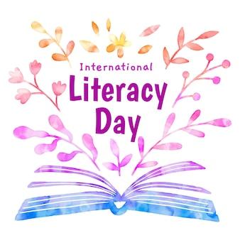 Livre ouvert et feuilles de la journée internationale de l'alphabétisation