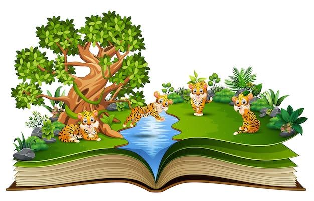 Livre ouvert avec groupe de dessin animé de tigre jouant dans la rivière