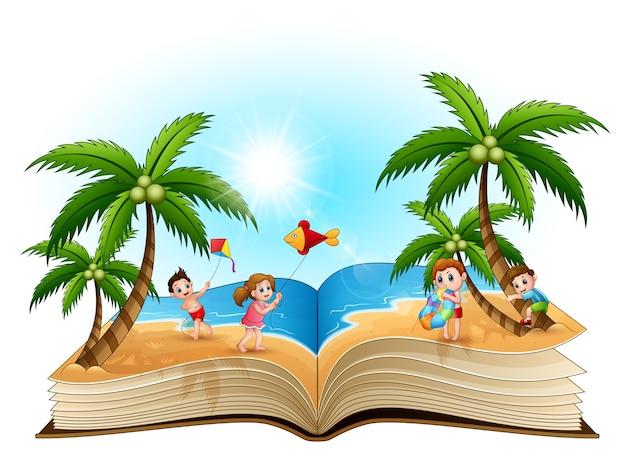 Livre ouvert avec un groupe d'enfants heureux jouant sur la plage