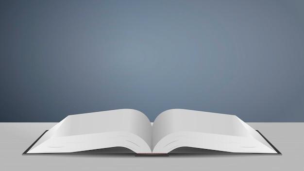 Livre ouvert noir sur la table. fond gris.