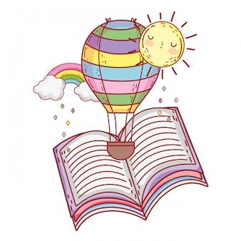 Livre de texte avec hélium arc-en-ciel et ballon