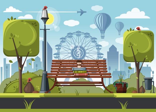 Livres et une tasse de café sur un banc de parc dans le parc d'attractions de la ville.