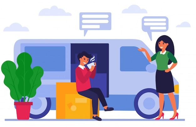 Livreur assis sur des boîtes et boire du café