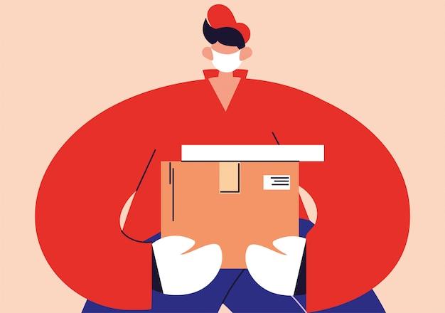Livreur avec masque facial porte une boîte en carton