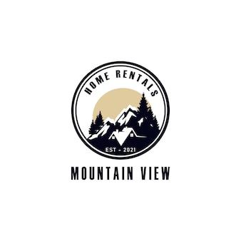 Location de maisons avec logo sur la montagne