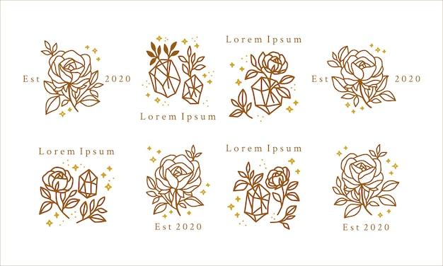Logo de beauté féminine dessiné à la main avec des fleurs d'or, des cristaux et des étoiles