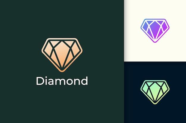 Logo de bijou ou bijou de luxe en forme de diamant de couleur or